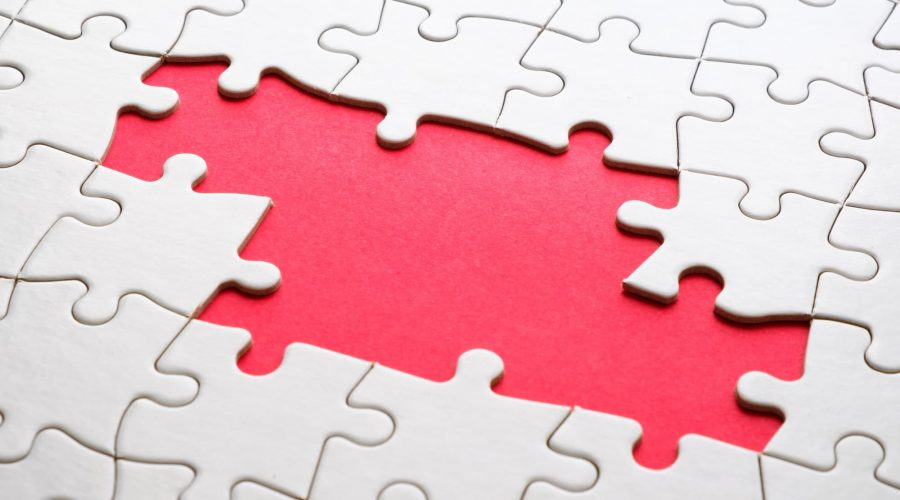 Jigsaw puzzle game piece on red background for business theme design